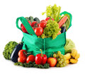 Green shopping bag with variety of fresh organic vegetables on white Royalty Free Stock Images