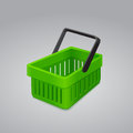 Green shopping basket on gray background Stock Photos