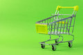 Green shopping cart close up of on background Royalty Free Stock Image