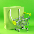 Green shopping cart and gift bag close up of Royalty Free Stock Image