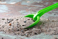 Green Shovel with sand Stock Images