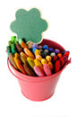 Green sign on metal bucket full of crayon you can put your design Stock Image