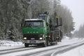 Green Sisu SM300 Truck Hauls Forestry Equipment in Winter