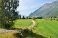 Green skjolden field and mountains in norway Stock Photography