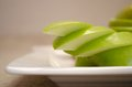 Green sliced apples juicy Ð¿reen on the plate Stock Image