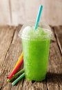 Green Slushie Drink in Plastic Cup with Straws Royalty Free Stock Photo