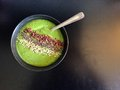 Green smoothie bowl with cacao nibs chia seeds and hemp seeds a healthy breakfast a thick served in a made banana mango pineapple Stock Photo