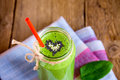 Green smoothie with heart of seeds Royalty Free Stock Photo