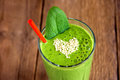 Green smoothie with heart of sesame seeds Royalty Free Stock Photo