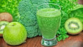 Green smoothie and the ingredients Stock Images