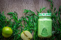 Green smoothie with spinach and apples in glass Royalty Free Stock Photo