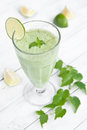 Green smoothie on white wooden table Royalty Free Stock Photos