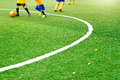 Green soccer field grass with white mark line and the boys play football background