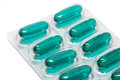 Green soft gel capsules pills in blister pack Royalty Free Stock Photo