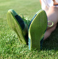 Green sole of shoes on grass gymnastics Royalty Free Stock Image