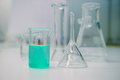 Green solution in glass beaker in science lab Royalty Free Stock Photo