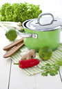 Green soup pot with Asian ingredients Stock Photo