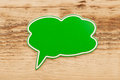 Green speech bubble wood background Royalty Free Stock Photo