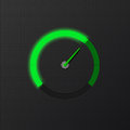 Green speedometer on carbon background
