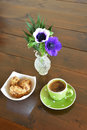 Green spotty mug and cookies vase with anemones Stock Photos