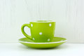 Green spotty mug on white background Stock Photos