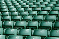 Green stadium seating rows of in a large sports Royalty Free Stock Photos