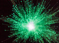 Green starburst burst of light on a black background Royalty Free Stock Images