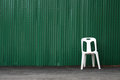 Green steel sheet and white chair Stock Image