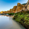 Green stones at porto de mos beach in lagos algarve portugal Royalty Free Stock Photos