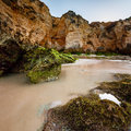Green stones at porto de mos beach in lagos algarve portugal Royalty Free Stock Image