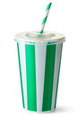 Green striped cardboard cup with a straw satnding on white Royalty Free Stock Images