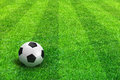 Green striped football field with soccer ball Stock Image