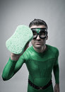 Green superhero cleaning with a sponge Royalty Free Stock Photo