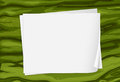 A green surface with empty papers Stock Image