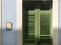Green swinging doors in old san juan puerto rico Royalty Free Stock Photos