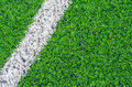 Green synthetic grass sports field with white line Stock Photos