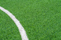 Green synthetic grass sports field with white line Stock Photography