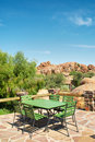 Green table with chairs in outdoor restaurant shot namibia Stock Photography
