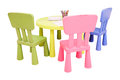Green table and colorful chairs Royalty Free Stock Photo