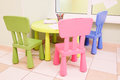 Green table and colorful chairs for little kids Royalty Free Stock Photo
