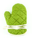 Green tableware or kitchen glove isolated on white Stock Photo
