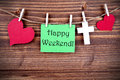 Green tag with happy weekend on a line heart and cross the words Stock Photography