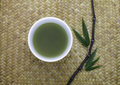 Green tea bowl  with bamboo leaves Royalty Free Stock Photos