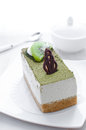 Green tea cake dessert piece with chocolate and kiwi Stock Photography