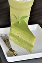 Green tea cake with tea leaf garnish fresh Royalty Free Stock Photo