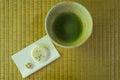 Green tea ceremony with cake Royalty Free Stock Photo