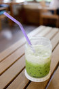 Green tea drink of cold milk on table. Royalty Free Stock Photo