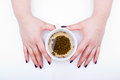 Green tea female hands holding a cup of natural Royalty Free Stock Photos