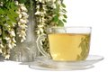 Green tea and flowers acacias Stock Image