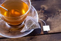 Green tea in glass teacup a on a rustic wooden table Royalty Free Stock Image